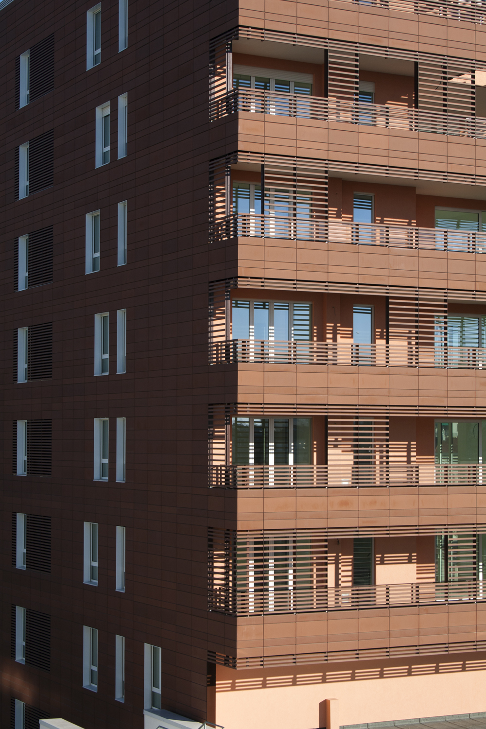 terramodus is a single extruded hollow terracotta panel with overlaps at upper and lower edges for invisible anchoring the calibrated length of the panel - Terra Cotta Tile Apartment 2015